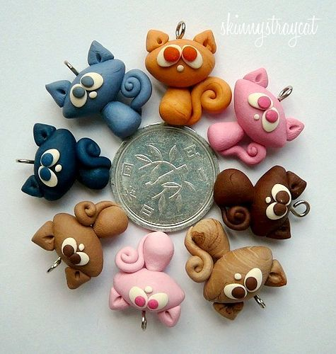 Confuzzled Cat charms,  They are arranged around a Japanese one-yen coin for size comparison.