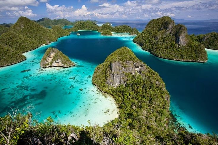 Raja Ampat, or the Four Kings, is an archipelago comprising over 1,500 small islands, cays, and shoals in the northwest tip of Bird's Head Peninsula on the island of New Guinea, off the northeastern coast of Indonesia's West Papua province.