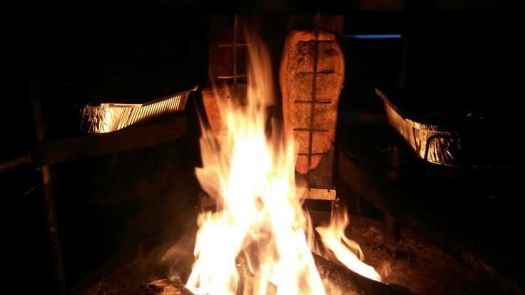 Salmon on open fire.
