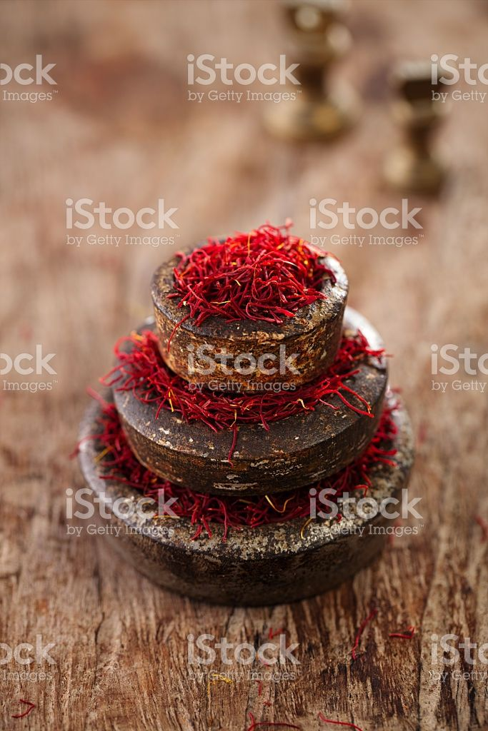 saffron spice in antique vintage iron bowls weights royalty-free stock photo