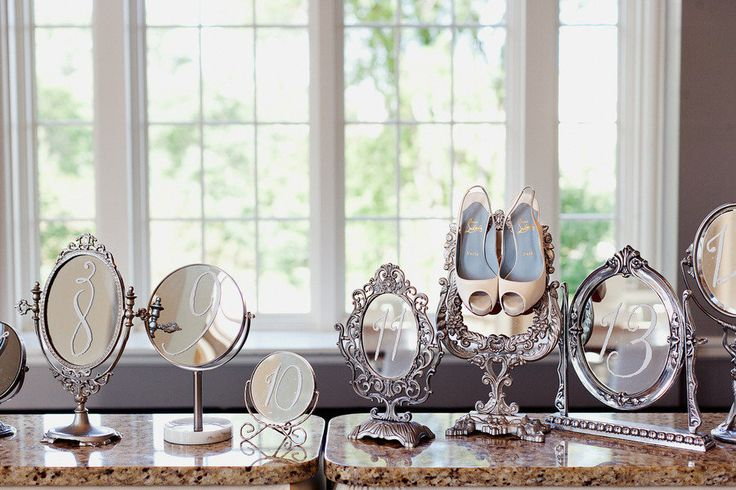 Love, Love, Love this hodge-podge of mirrors used for table numbers!