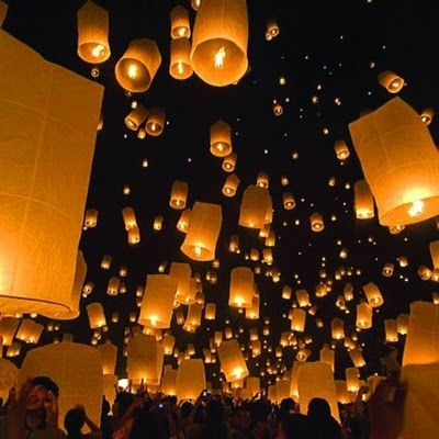 "Flying Paper Lanterns. Sell them during the event and all release with ""wishes"" as they leave."