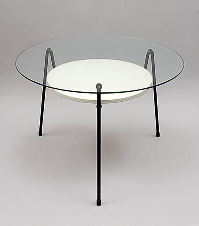 Side-table 535 black lackered metal frame on which a round glass tabletop and a lackered metal top in between design Wim Rietveld 1953 executed by Gispen Culemborg / the Netherlands