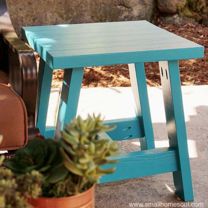 Make your own 2x4 Outdoor Table with simple and inexpensive building materials to get stylish furniture for your patio on a small budget.