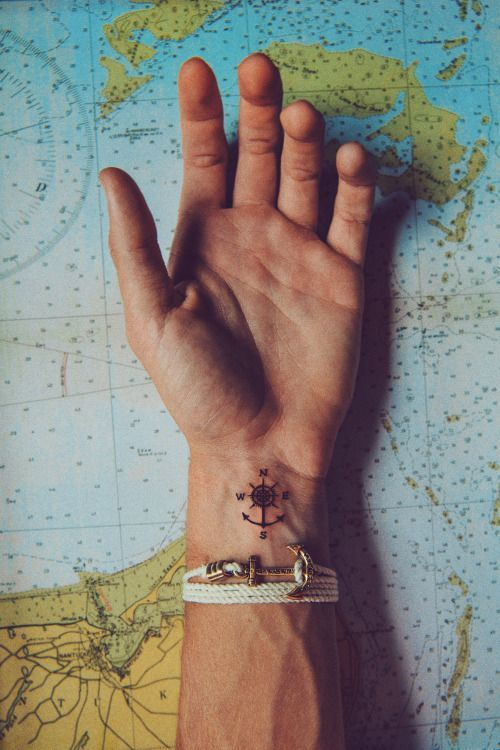 Men's compass and nautical tattoos are trending on Pinterest.