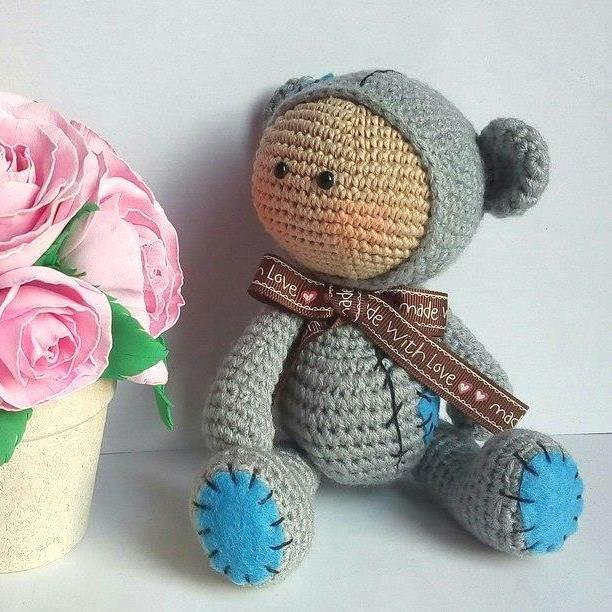 Amigurumi baby doll in teddy costume - free crochet pattern