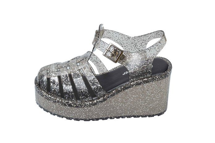 This shoes is perfect for spring and summer time, multiple color can go with different outfits. The ankle strap is adjustable, he foot bed is padded, which is very supportive wearing wearing. The wedge design is style and comfortable. The jelly material is also water proof, perfect to wear to beach too.