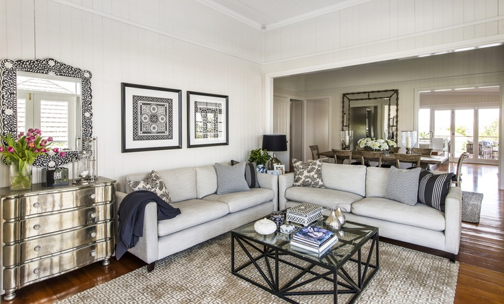 INTERIORS BY HIGHGATE HOUSE This living rooms neutral colour palette mixed with neutral tones and textures in the rug and cushions create a relaxed and elegant feel.