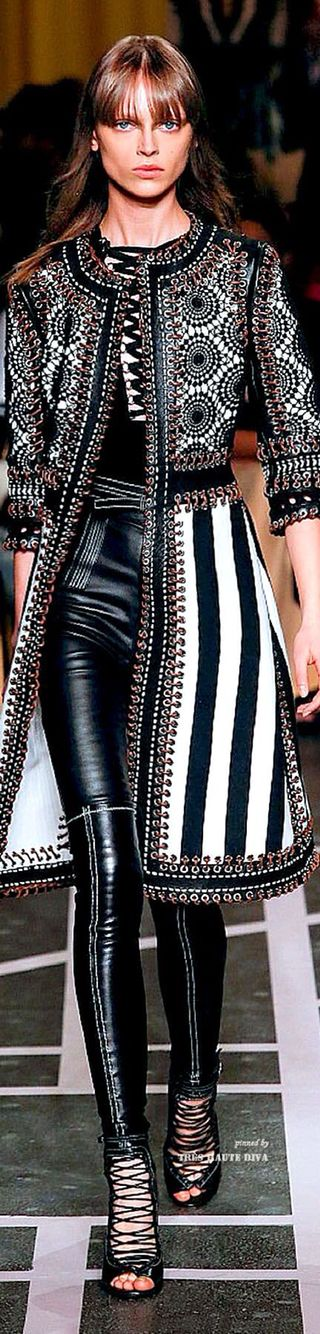 Givenchy Spring/Summer 2015 Clash of monochrome prints, leather, the corset detailing on the top and strappy heels and the finer details such as the brass rings along the entire jacket...Givenchy just like Saint Laurent is one of my favourite designers they always get it right
