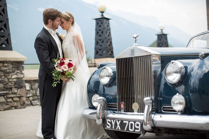 Bride and groom with their vintage Rolls Royce at the Fairmont Banff Springs Hotel.  Flowers by Janie- Calgary Wedding Florist www.flowersbyjanie.com Photo: http://www.ericdaigle.com