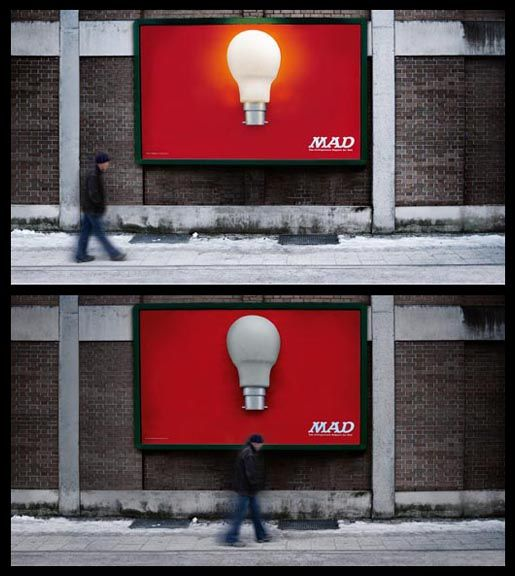 """In 2004 The Economist, the business magazine, worked with BBDO to install a billboard with a light bulb. When anyone walked underneath it, the light turned on. In 2011 the humor magazine MAD installed a billboard with a light bulb. When anyone walked underneath it, the light turned off."""