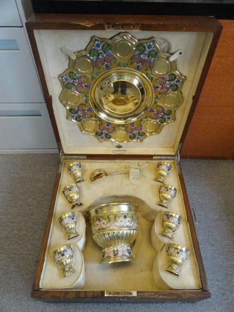 A beautiful antique Russian Faberge silver 88 cloisonne shaded and jeweled enamel punch set, circa 1894. Diameter of tray is 19.75 inches. Height of bowl is 7.625 inches. Weight of bowl is 1.343kg. Length of ladle is 10.75 inches. Weight of ladle is 206 grams. Height of each cup is 3.5 inches. Weight of all 8 cups is 1.297kg.
