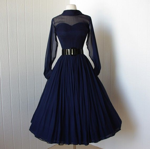 vintage 1950's dress   ...beautiful navy silk chiffon full skirt bombshell dress with pintucked nude illusion bodice and billowing sleeves   ...a true classic