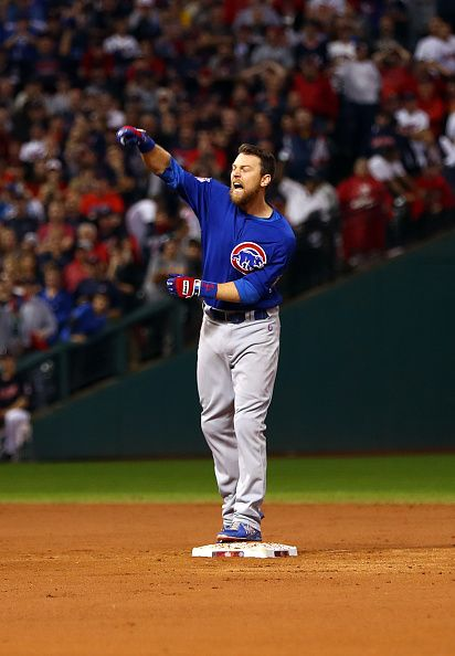Ben Zobrist of the Chicago Cubs reacts to hitting the go ahead RBI single in the 10th inning during Game 7 of the 2016 World Series against the...