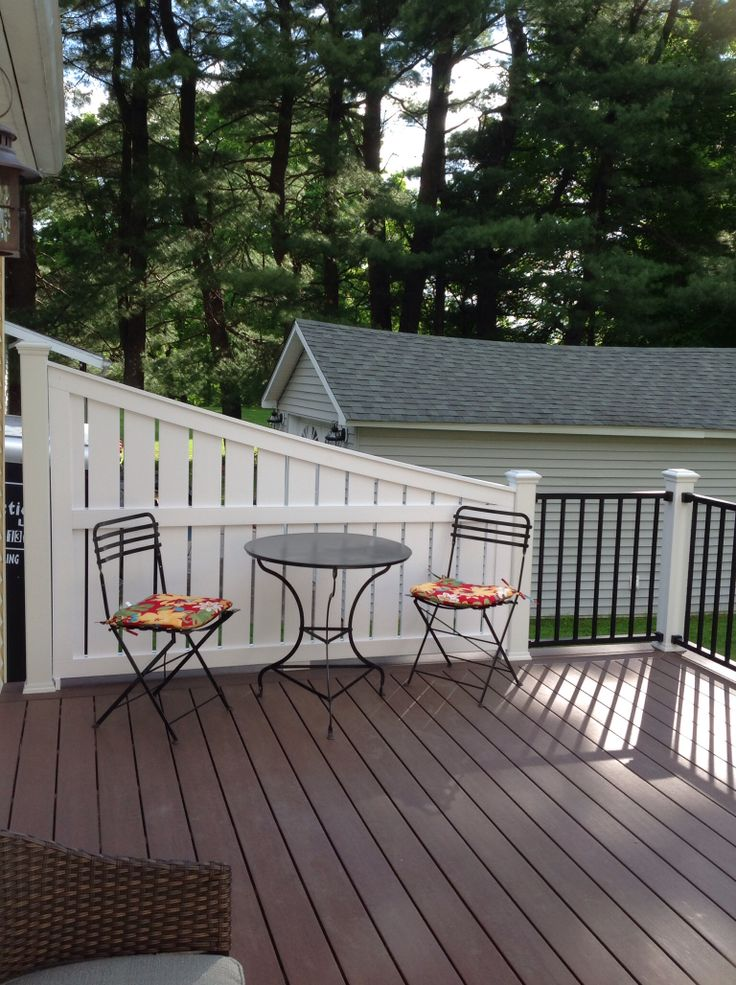 Vinyl deck privacy azek acacia decking with trex reveal for Privacy shutters for deck