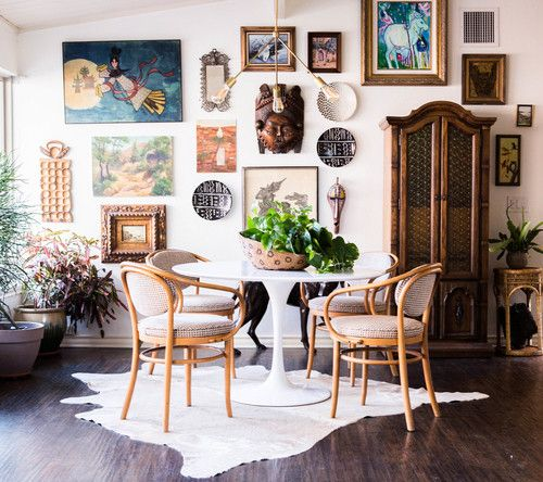 Boho gallery wall with multi-finish frames and wall sculptures for an eclectic style