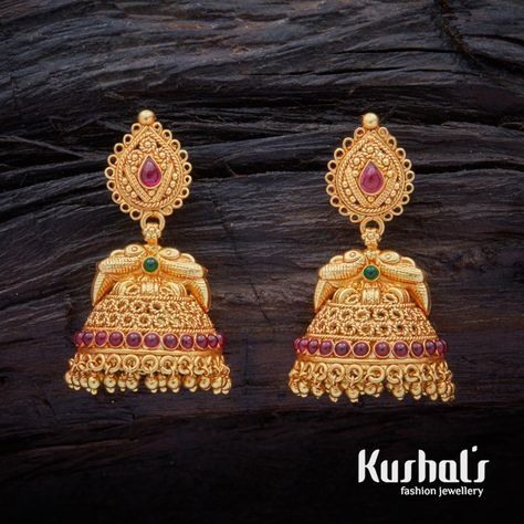 A stunning pair of South Indian Traditional Silver Temple Ruby Green Jhumka Earrings with Hanging Beads & spinal stones. this pair makes for great festive wear.