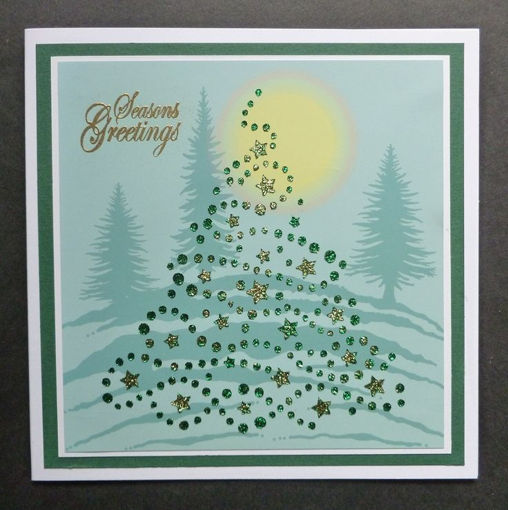 'Star Tree in the Forest' card. - Imagination Craft's - Forest green & Gold shine Sparkle Mediums.  Metal spatula.  Star Tree stencil.  Detail gold embossing powder.  Versamark pad.  Fir trees background card.  Season's Greeting stamp.   June 2017.   Designed by Jennifer Johnston.