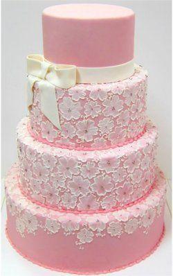 this is a very cute cake and definitely not overly pink. #pinkandwhite #weddingcake #pinkweddingcake #flowers #bow