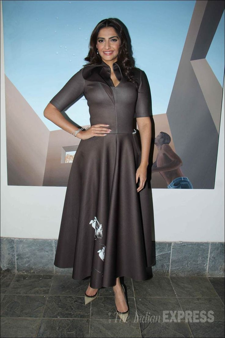 Sonam Kapoor posing for the cameras after an interview.