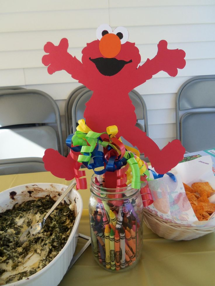 Use Mason Jars as base for the Elmo Centerpieces... crayons, makers, glass stones, etc...