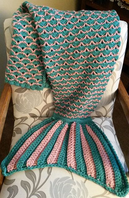 This Mermaid Tail Blanket is crocheted with V-stitches and shell stitches for the cocoon, and double crochet for the fin.