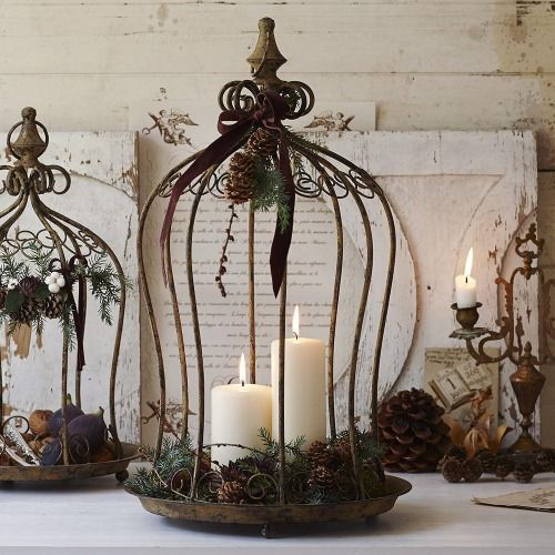 Candles in bird cages. I have a similar cage that I use as a bird feeder.