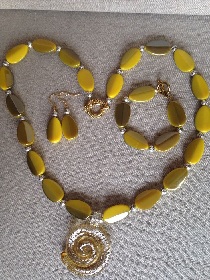 A personal favorite from my Etsy shop https://www.etsy.com/listing/235752533/mustard-yellow-acrylic-beaded-necklace