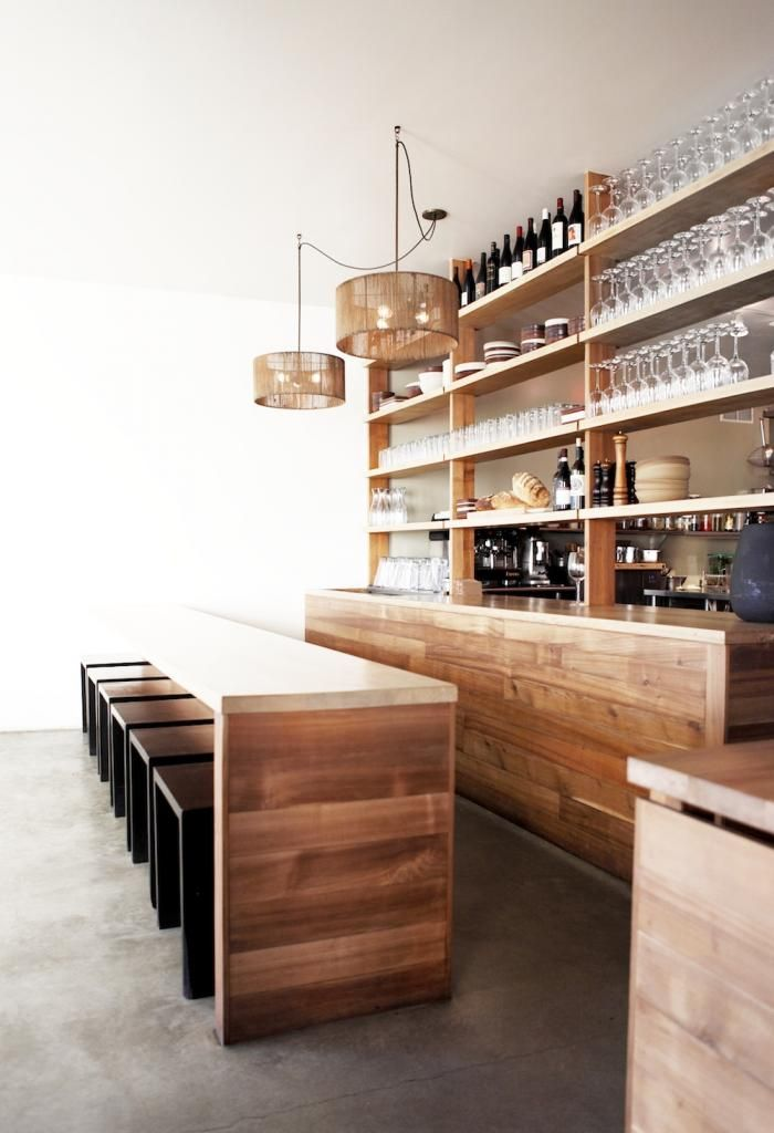 Open shelving separates the kitchen from the dining room. The jute pendant lamps are also a Moore design. Venice beach restaurant