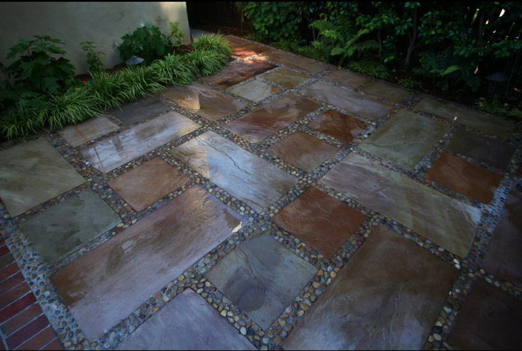 Stained Concrete Patios In Square And Rectangle Pattern