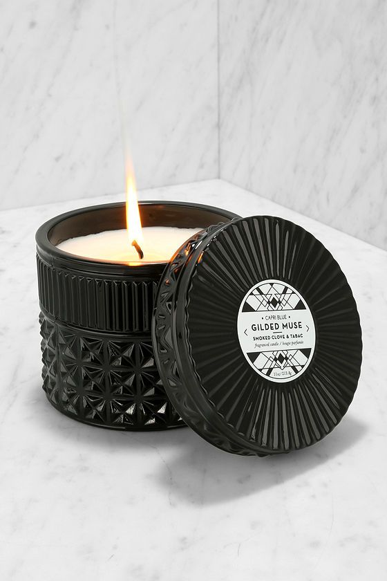 Let your earthly delights include lovely little things like the Capri Blue Gilded Muse Smoked Clove and Tabac Candle! This artisan-made soy wax candle has a pleasing scent of ginger, clove, geranium, and tobacco in a faceted, black glass lidded jar. 40 hour burn time offers endless nights of entertaining, or me-time.