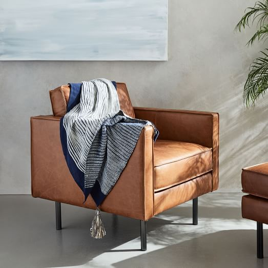 Our Axel Leather Chair features the highest quality aniline-dyed leather on a simple industrial form, with bench cushioning, flanged edges and modern metal legs.
