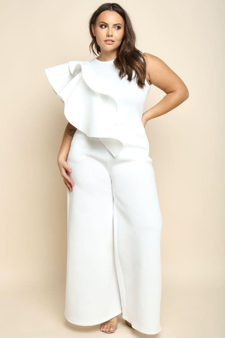 A plus size sleeveless jumpsuit with a round neckline and palazzo pants. Features ruffled trims on the right shoulder. Solid colored all over.