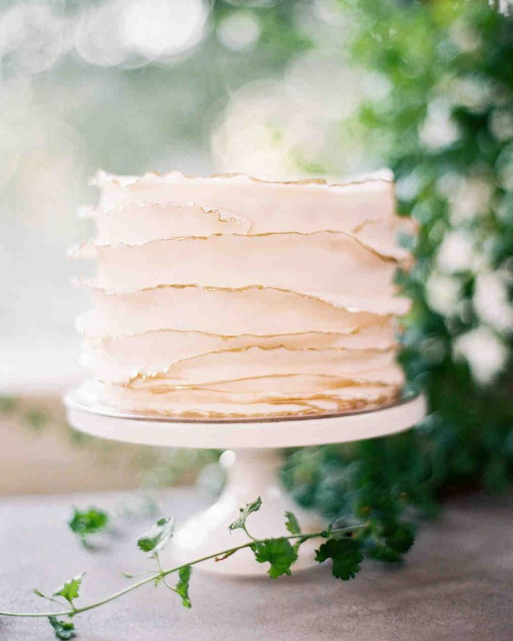 Trending Now: Deckle-Edged Wedding Cakes | Martha Stewart Weddings - Deckled edges don't have to be reserved just for the topmost layer of your wedding cake. This single-tiered dessert featured layers of deckle-edged fondant, complete with gold-tipped edges.