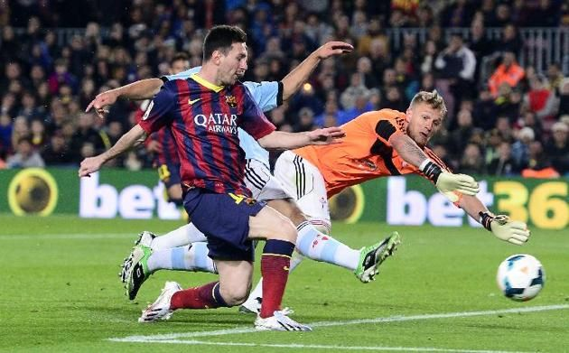FC Barcelona's Lionel Messi from Argentina scores against Celta Vigo's goalkeeper Ruben Blanco during a Spanish La Liga soccer match at the ...