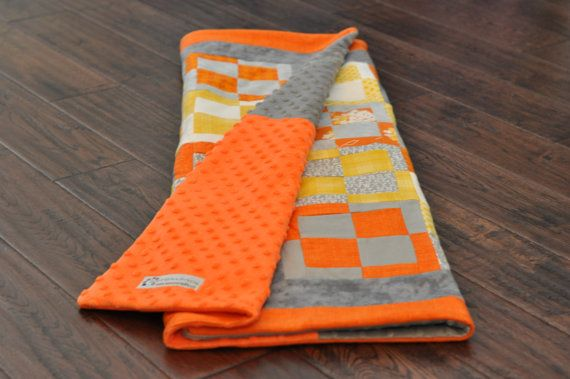 Modern geometric orange and yellow and grey baby quilt. Flannel and minky fabric.