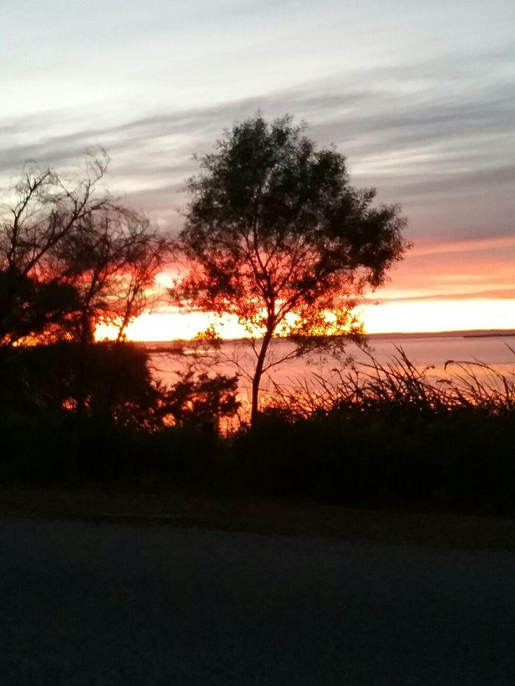 This photo was taken by me on 110616.  Winter sunrise across the estuary. It has nothing to do with foursquare.com