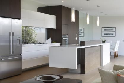 trendsideas.com: architecture, kitchen and bathroom design: A modern family kitchen with an island, in white and timber veneer, by Ryan Designer Homes