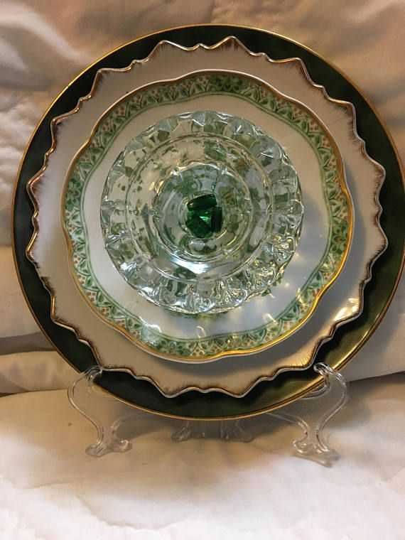 Not all glass flowers are outside flowers! This one is designed to sit on a plate stand. Stand is not included. (Or for an additional $5.00, I can customize so it will hang OR be an outdoor glass flower for your garden) Uses vintage glass. First is a dark green plate. Next is a gold