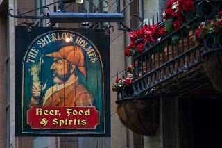 The lanes and alleys of Melbourne are full of small pubs and bars which are packed on Friday and Saturday nights. The wooden sign board of the Sherlock Holmes, on Collins Street. I think the flowering pot plants also added to the image.