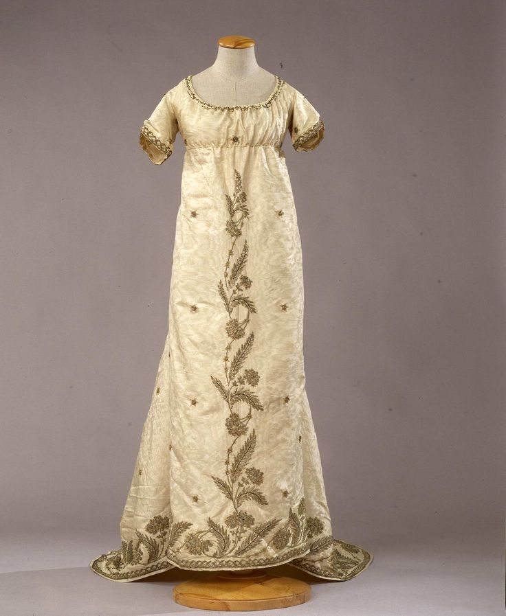 Evening dress in ivory moire, ca. 1800.  Click through and use the arrows at the top to see excellent detail images.