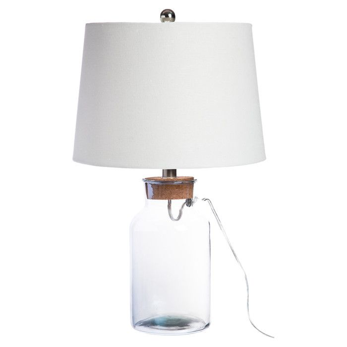 Display seashells beads or a vintage marble collection in this versatile table lamp showcasing a clear glass base and cork style top