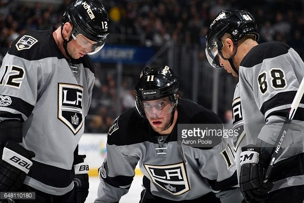 Anze Kopitar #11, Marian Gaborik #12, and Jarome Iginla #88 of the Los Angeles Kings chat before a face-off during the game against the Vancouver Canucks on March 4, 2017 at Staples Center in Los Angeles, California. #LAKings #WeAreAllKings