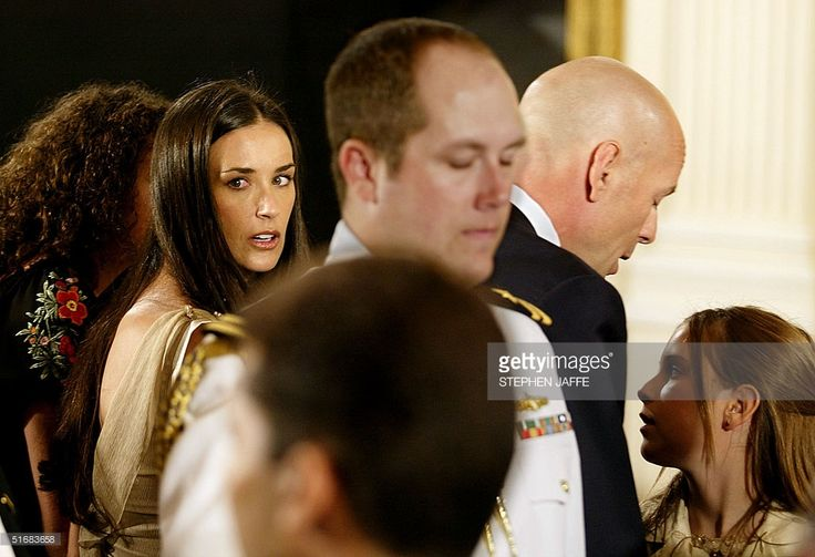Actress Demi Moore (2nd L) and actor Bruce Willis (2nd R) stand with their children Rumer (L) and Talluhah Belle (R) as US President George W. Bush announced a new initiative to increase public awareness and encourage Americans to consider adoption of children in foster care during an event in the East Room 23 July 2002 at the White House. The President tapped Bruce Willis to serve as a national spokesperson for children in foster care. AFP PHOTO/Stephen JAFFE