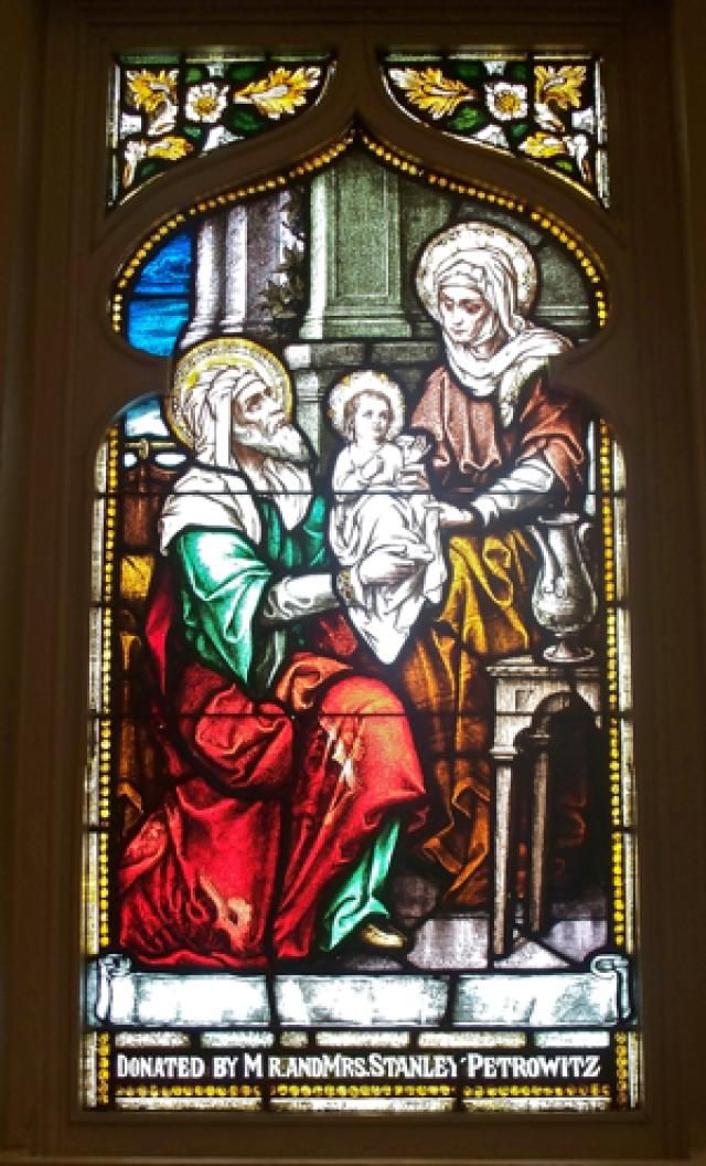 A Prayer to Saint Joachim, Father of the Virgin Mary: Stained-glass window of The Blessed Virgin Mary as a Baby With Saints Joachim and Anna, in Saint Mary Cathedral, Lansing, Michigan.
