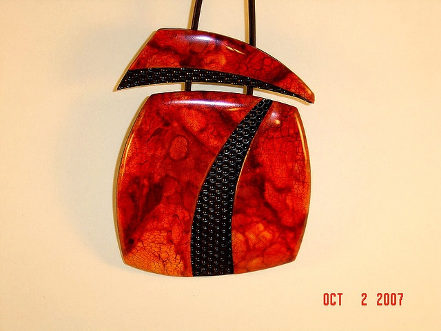 Red pendant by pcbysusan, via Flickr.
