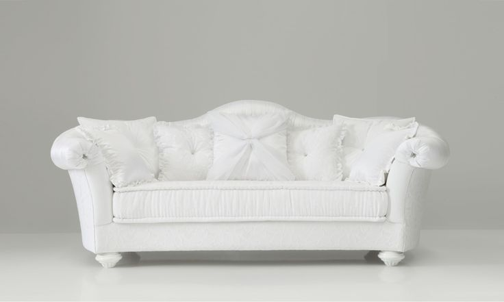 Luxury classic sofa with precious details: jewels and uniqueness of fine craftsmanship