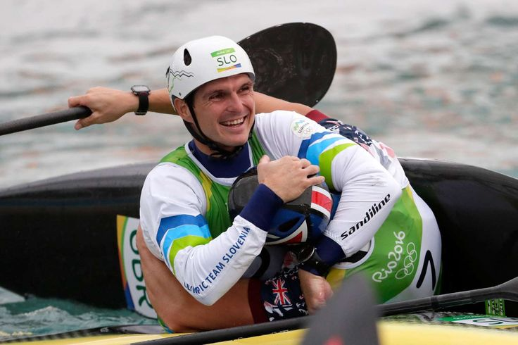 Winning hug:    Peter Kauzer of Slovenia shares a fun moment with Joseph Clarke of Great Britain after winning silver and gold, respectively, in the Men's kayak single final.     -   2016 Rio Olympics: Highs and lows from day five