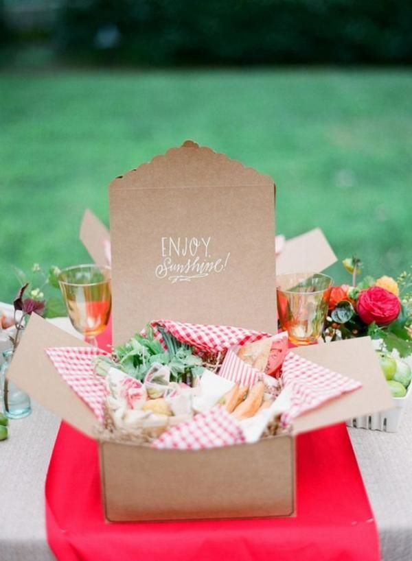 A paper lunch box with floral decor for a picnic bridal shower or summer wedding event.