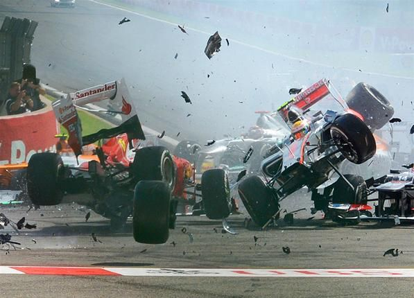 (L to R): Fernando Alonso (ESP) Ferrari F2012 and Lewis Hamilton (GBR) McLaren MP4-27 crash out at the start of the race.  Formula One World Championship, Rd12, Belgian Grand Prix, Race, Spa-Francorchamps, Belgium, Sunday, 2 September 2012